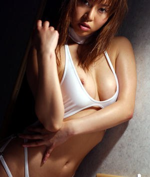 Loveable asian babe Adusa Kyono uncovering her petite titties