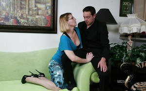 Fully clothed mature lady in glasses gives a handjob and gets a facial