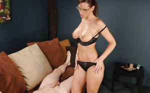 Big busted mature brunette in glasses gives a handjob and gets a facial