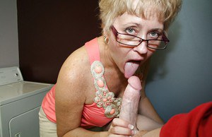 Short haired mature lady in glasses jerking and sucking a big cock