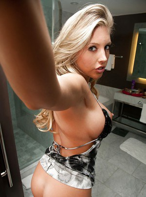 Stunning blonde babe on high heels showcasing her big tits and hot ass