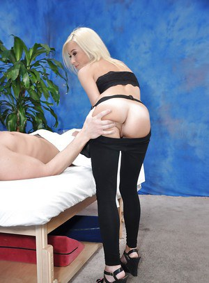 Slim blonde babe with neat ass gets screwed hardcore on the massage table