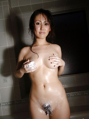 Busty asian babe in lingerie and stockings stripping and taking a bath
