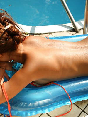 Stunning asian babe Yoko Yoshikawa slipping off her bikini by the pool