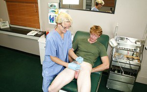 Slutty blonde babe in nurse uniform and glasses jerking off a big cock