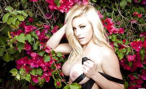 Hot babe Kari Nautique stripping off her lingerie and getting blindfolded