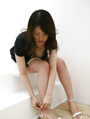 Seductive asian babe Takako Kitahara slipping off her clothes