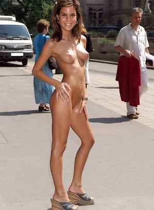 Graceful amateur babe with amazing tits posing naked in public place