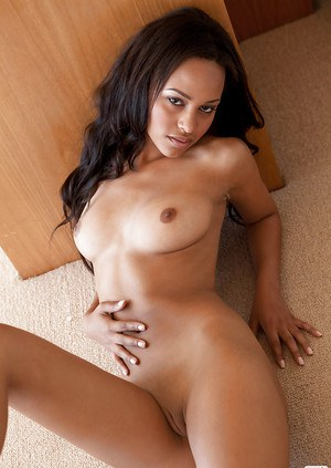 Lovely ebony babe Kaylia Cassandra slipping off her lingerie
