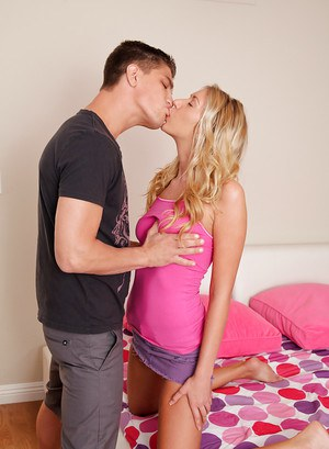 Pretty blonde gives a guy a footjob 6