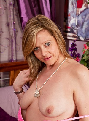 Sexy mature lady Louise Pearce stripping off her dress and lingerie