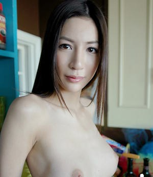 Amateur asian babe with big tits stripping and posing naked on the bed