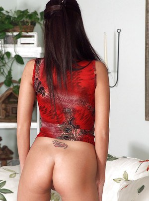 Seductive brunette taking off her lingerie and toying her pink pussy