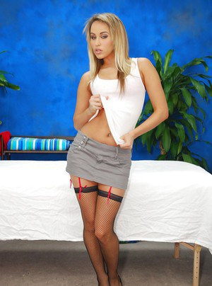 Lustful blonde teen babe in stockings stripping and posing in lingerie