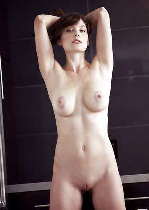 Lovely babe with petite tits Lisa Kate stripping off her clothes