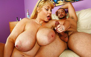 Fatty blonde MILF with giant flabby boobs gives sensual tugjob