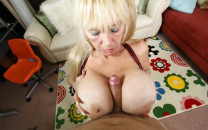 Lusty granny with giant boobs sucks a cock and gives a titjob