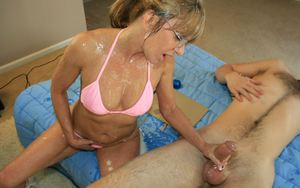 Naughty mature lady in glasses gets bukkaked after a handjob
