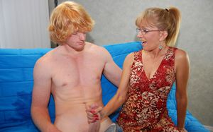 Mature lady in fancy dress gives a tugjob and gets bukkaked