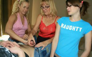 Mature blonde in glasses teaching her teen friends how to stroke a big cock
