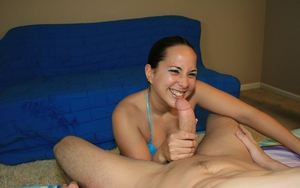 Petite brunette in bikini gives a handjob and gets facialized
