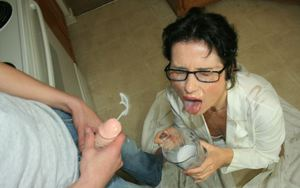 Slutty mature brunette in glasses gives a blowjob and gets bukkaked