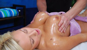Naughty blonde babe with big tits gets banged hardcore after massage