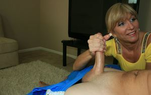 Lascivious blonde MILF strokes a cock and gets rewarded with a cumshot