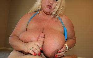 Naughty plumper with huge flabby jugs jerking off a stiff cock