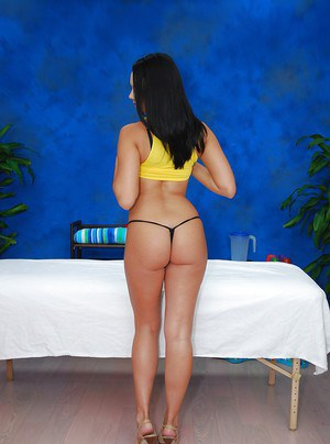 Hot teen babe on high heels taking off her clothes in the massage parlor