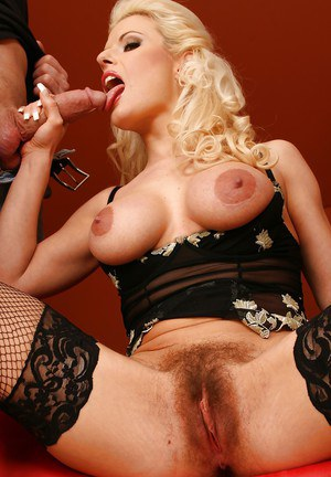 Big busted blonde babe in stockings gets her hairy cunt drilled hardcore