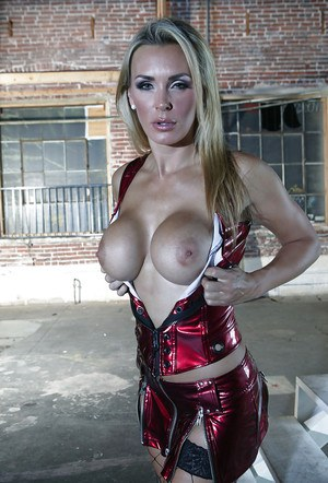 Sexy MILF in fishnet stockings Tanya Tate uncovering her big round tits