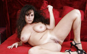 Fatty brunette MILF with massive flabby boobs taking off her panties