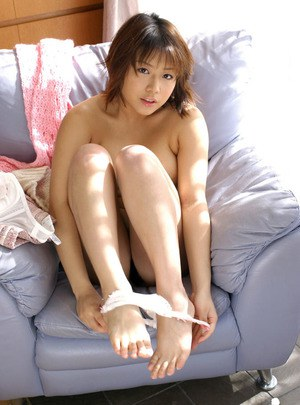 Big busted asian babe Mai Haruna stripping and licking her hard nipples