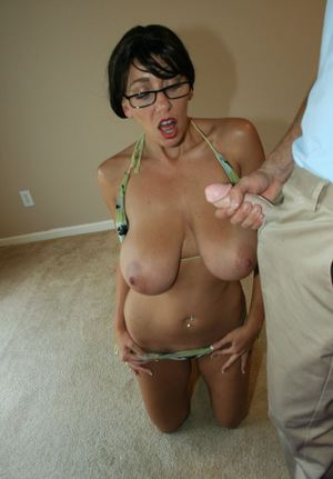 Big busted brunette in glasses gives a blowjob and gets bukkaked