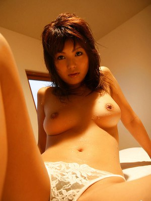 Alluring asian babe Azumi Harusaki taking off her panties on the bed