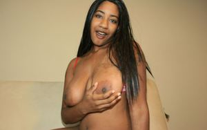 Long haired ebony babe in jeans uncovering her big flabby tits