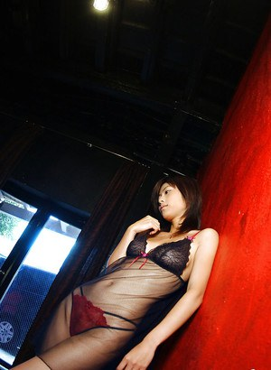 Seductive asian babe Rin Suzuka exposing her nice jugs and hairy pussy