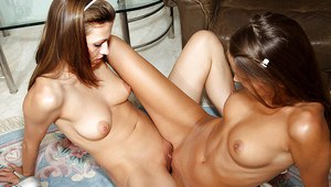 Fuckable amateur lesbians stripping and having fun with a huge strapon