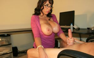 Raunchy mature brunette in glasses pops out her massive jugs to give a tugjob