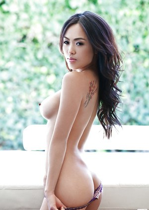 Sweet asian cutie with big melons Kitty Lee stripping off her lingerie