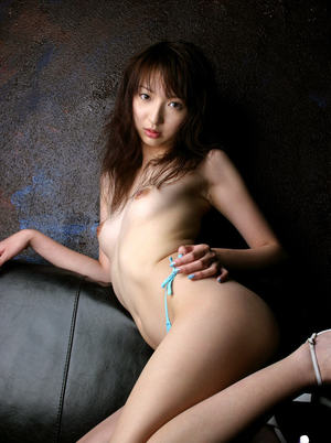 Slutty asian babe uncovering her petite titties and unshaven pussy
