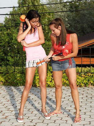 Two lesbian teen girls kissing and enjoying deep fisting in the garden