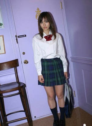 Naughty asian schoolgirl Hikaru Koto slipping off her uniform
