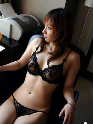 Naughty asian babe in glasses stripping and teasing her bush