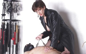 Lascivious mature fetish lady torturing her human pet's cock