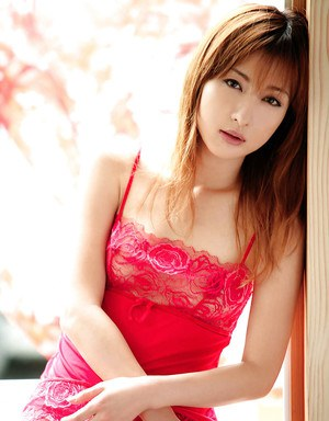 Slender asian chick in red lingerie uncovering her perky tits and hairy cunt