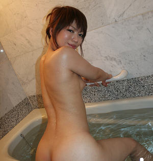 Svelte asian slut with neat fanny takes a shower and gets her pussy fingered