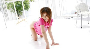 Seductive asian coed Hitomi Yoshino uncovering her petite curves