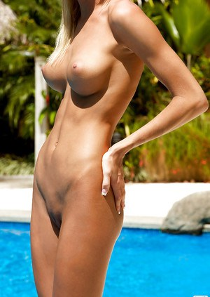 Alluring blonde babe Eliza Carson showcasing her perfect body outdoor